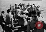 Image of Troops load supplies on Higgins Boats Solomon Islands, 1944, second 61 stock footage video 65675053483