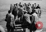 Image of Troops load supplies on Higgins Boats Solomon Islands, 1944, second 62 stock footage video 65675053483