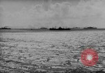 Image of amphibious invasion Pacific Theater, 1944, second 16 stock footage video 65675053522