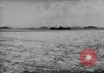 Image of amphibious invasion Pacific Theater, 1944, second 17 stock footage video 65675053522