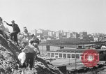 Image of hills of sawdust Portland Oregon USA, 1941, second 17 stock footage video 65675053569