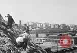 Image of hills of sawdust Portland Oregon USA, 1941, second 18 stock footage video 65675053569