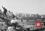 Image of hills of sawdust Portland Oregon USA, 1941, second 19 stock footage video 65675053569