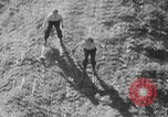 Image of hills of sawdust Portland Oregon USA, 1941, second 31 stock footage video 65675053569