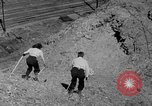 Image of hills of sawdust Portland Oregon USA, 1941, second 40 stock footage video 65675053569