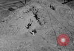 Image of hills of sawdust Portland Oregon USA, 1941, second 42 stock footage video 65675053569