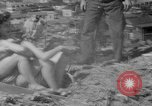 Image of hills of sawdust Portland Oregon USA, 1941, second 47 stock footage video 65675053569