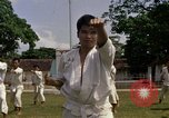 Image of karate class South Vietnam, 1967, second 23 stock footage video 65675053590