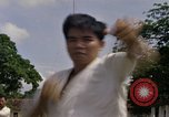Image of karate class South Vietnam, 1967, second 27 stock footage video 65675053590