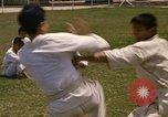 Image of karate class South Vietnam, 1967, second 14 stock footage video 65675053591