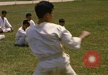Image of karate class South Vietnam, 1967, second 15 stock footage video 65675053591