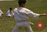 Image of karate class South Vietnam, 1967, second 16 stock footage video 65675053591