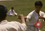 Image of karate class South Vietnam, 1967, second 21 stock footage video 65675053591