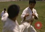 Image of karate class South Vietnam, 1967, second 22 stock footage video 65675053591