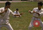 Image of karate class South Vietnam, 1967, second 24 stock footage video 65675053591