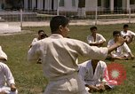 Image of karate class South Vietnam, 1967, second 28 stock footage video 65675053591