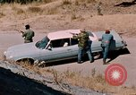 Image of vehicle ambush counter-attack ramming techniques California United States USA, 1976, second 21 stock footage video 65675053608