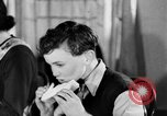 Image of British citizens listen to radio broadcasts London England United Kingdom, 1936, second 38 stock footage video 65675053653