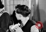 Image of British citizens listen to radio broadcasts London England United Kingdom, 1936, second 39 stock footage video 65675053653