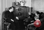 Image of British citizens listen to radio broadcasts London England United Kingdom, 1936, second 54 stock footage video 65675053653