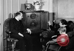 Image of British citizens listen to radio broadcasts London England United Kingdom, 1936, second 55 stock footage video 65675053653