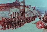 Image of German troops marching to surrender to Western Allies Pilsen Czechoslovakia, 1945, second 8 stock footage video 65675055608
