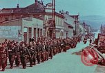 Image of German troops marching to surrender to Western Allies Pilsen Czechoslovakia, 1945, second 9 stock footage video 65675055608