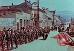 Image of German troops marching to surrender to Western Allies Pilsen Czechoslovakia, 1945, second 15 stock footage video 65675055608