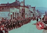 Image of German troops marching to surrender to Western Allies Pilsen Czechoslovakia, 1945, second 18 stock footage video 65675055608