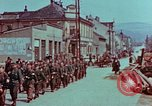 Image of German troops marching to surrender to Western Allies Pilsen Czechoslovakia, 1945, second 23 stock footage video 65675055608