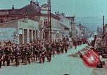 Image of German troops marching to surrender to Western Allies Pilsen Czechoslovakia, 1945, second 54 stock footage video 65675055608