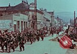 Image of German troops marching to surrender to Western Allies Pilsen Czechoslovakia, 1945, second 59 stock footage video 65675055608