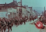 Image of German troops marching to surrender to Western Allies Pilsen Czechoslovakia, 1945, second 60 stock footage video 65675055608