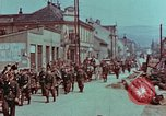 Image of German troops marching to surrender to Western Allies Pilsen Czechoslovakia, 1945, second 62 stock footage video 65675055608