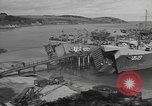 Image of U.S. Army Vehicles being loaded on LSTs before D-Day Falmouth England United Kingdom, 1944, second 10 stock footage video 65675060406