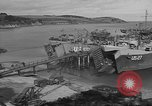 Image of U.S. Army Vehicles being loaded on LSTs before D-Day Falmouth England United Kingdom, 1944, second 12 stock footage video 65675060406