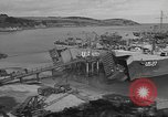 Image of U.S. Army Vehicles being loaded on LSTs before D-Day Falmouth England United Kingdom, 1944, second 15 stock footage video 65675060406