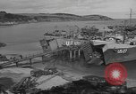 Image of U.S. Army Vehicles being loaded on LSTs before D-Day Falmouth England United Kingdom, 1944, second 16 stock footage video 65675060406