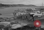 Image of U.S. Army Vehicles being loaded on LSTs before D-Day Falmouth England United Kingdom, 1944, second 18 stock footage video 65675060406