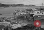 Image of U.S. Army Vehicles being loaded on LSTs before D-Day Falmouth England United Kingdom, 1944, second 20 stock footage video 65675060406