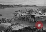 Image of U.S. Army Vehicles being loaded on LSTs before D-Day Falmouth England United Kingdom, 1944, second 22 stock footage video 65675060406