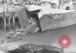 Image of U.S. Army Vehicles being loaded on LSTs before D-Day Falmouth England United Kingdom, 1944, second 23 stock footage video 65675060406