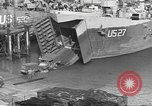 Image of U.S. Army Vehicles being loaded on LSTs before D-Day Falmouth England United Kingdom, 1944, second 24 stock footage video 65675060406