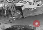 Image of U.S. Army Vehicles being loaded on LSTs before D-Day Falmouth England United Kingdom, 1944, second 25 stock footage video 65675060406