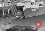 Image of U.S. Army Vehicles being loaded on LSTs before D-Day Falmouth England United Kingdom, 1944, second 27 stock footage video 65675060406