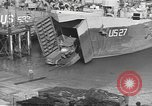 Image of U.S. Army Vehicles being loaded on LSTs before D-Day Falmouth England United Kingdom, 1944, second 29 stock footage video 65675060406