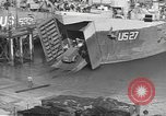 Image of U.S. Army Vehicles being loaded on LSTs before D-Day Falmouth England United Kingdom, 1944, second 32 stock footage video 65675060406