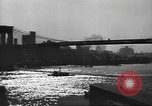 Image of City scenes including bridges, buildings, streets and traffic Brooklyn New York USA, 1947, second 22 stock footage video 65675060412