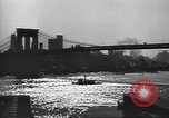 Image of City scenes including bridges, buildings, streets and traffic Brooklyn New York USA, 1947, second 23 stock footage video 65675060412