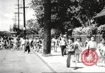 Image of everyday lifestyle and diverse population in Hawaii before World War 2 Honolulu Hawaii USA, 1941, second 49 stock footage video 65675060935